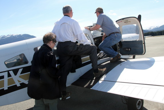 Mom and Dad and the pilot board the Piper Cherokee Six